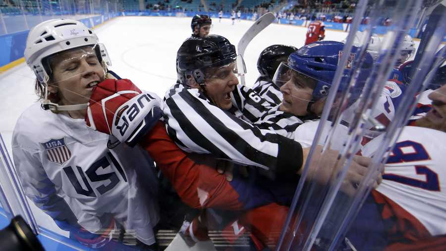 Referees break up fight between the United States and the Czech Republic players during the first period of the quarterfinal round of the men's hockey game at the 2018 Winter Olympics in Gangneung, South Korea, Wednesday, Feb. 21, 2018