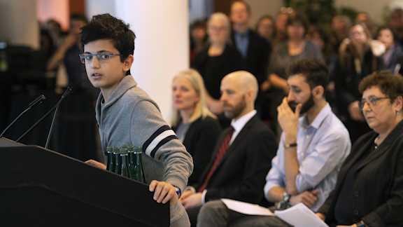 Ryan Pourjam, 13, son of Mansour Pourjam, speaks about his father during a ceremony on Wednesday, Jan. 15, 2020 at Carleton University in Ottawa to honor Pourjam, a biology alumnus, and biology PhD student Fareed Arasteh, who died in the crash of Ukraine International Airlines Flight PS752 in Tehran.