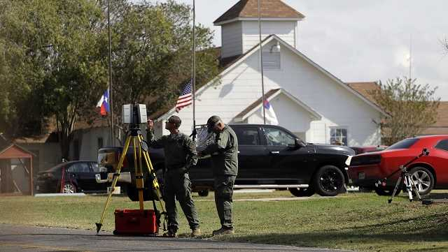 Flags fly at half-staff as law enforcement officials continue to investigate the scene of a shooting at the First Baptist Church of Sutherland Springs, Tuesday, Nov. 7, 2017, in Sutherland Springs, Texas.