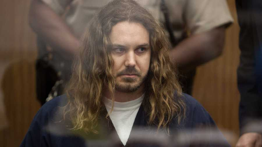 Tim Lambesis, 32, front man for the Christian-inspired heavy metal group As I Lay Dying, appears in Vista Superior Court in Vista, Calif. on Thursday, May 9, 2013. Labesis, who allegedly tried to hire a hit man to kill his wife, pleaded not guilty to a single count of solicitation for murder. He faces up to nine years in prison if convicted.