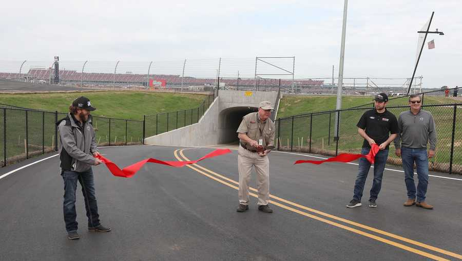 "NASCAR drivers Jeffrey Earnhardt (left) and Chase Briscoe (second from right) joined Talladega Superspeedway Chairman Grant Lynch (center), and Lance Taylor (far right) from Taylor Corporation, who spearheaded the tunnel construction efforts, in the ribbon cutting ceremony on Wednesday as part of the ""official"" Grand Opening for fans to enter the track's iconic infield."