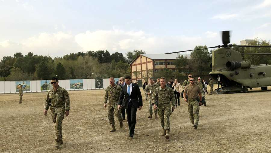 U.S. Defense Secretary Mark Esper, center, walks Gen. Scott Miller, right, chief of the U.S.-led coalition in Afghanistan, at the U.S. military headquarters in Kabul, Afghanistan, Sunday, Oct. 20, 2019.