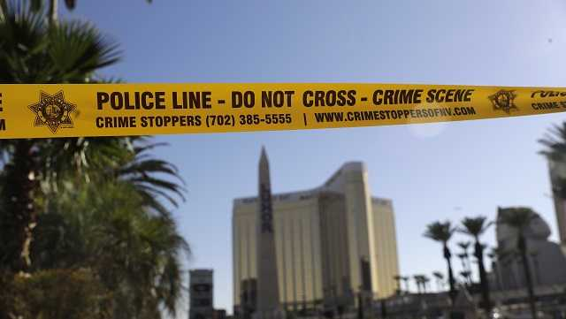 Part of Reno Ave. near South Las Vegas Blvd is blocked with police tape in the aftermath of a mass shooting Wednesday, Oct. 4, 2017, in Las Vegas.