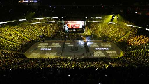 The names of people killed during the Oct. 1, 2017, mass shooting are projected on the ice during a ceremony before an NHL hockey game between the Vegas Golden Knights and the San Jose Sharks, Saturday, March 31, 2018, in Las Vegas.