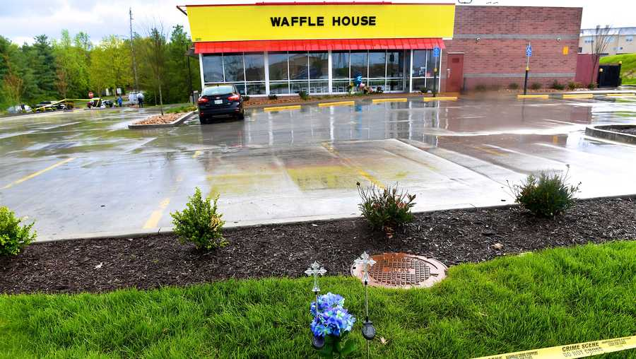 Community members create makeshift memorials for and stop by to pay respects to the victims of the Waffle House shooting on April 24, 2018 in Antioch, Tennessee, where 4 were killed on April 22.