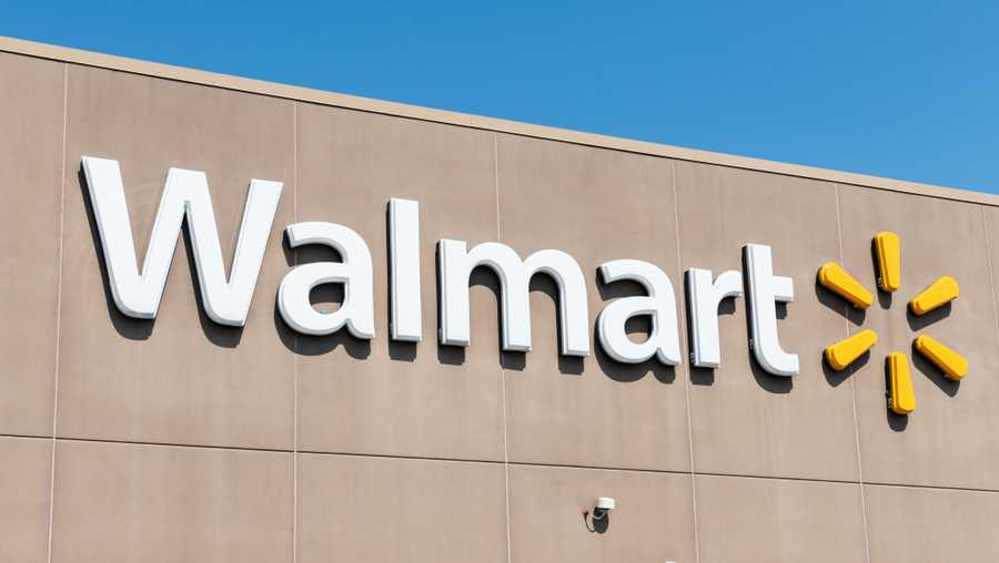 Walmart's logo is shown on the side of a store
