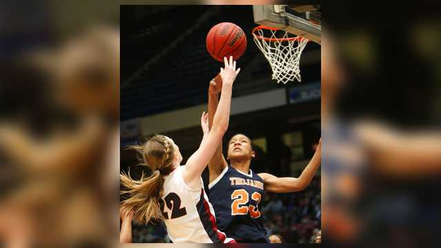 "FILE - In this Feb. 26, 2014, file photo, Oneonta's Abby Blackwood, left, shoots over Charles Henderson's Maori Davenport in a girls' Class 4A state basketball semifinal, in Birmingham, Ala. Alabama high school officials are defending the season-long suspension of a top girls basketball player over money she received from USA Basketball. Charles Henderson High School senior and Rutgers signee Maori Davenport was ruled ineligible this season on Nov. 30 after receiving an $857.20 check from USA Basketball for ""lost wages"". She represented the organization in a tournament in Mexico City over the summer."