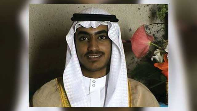 In this image from video released by the CIA, Hamza bin Laden is seen as an adult at his wedding. The never-before-seen video of Osama bin Laden's son and potential successor was released Nov. 1, 2017, by the CIA in a trove of material recovered during the May 2011 raid that killed the al-Qaida leader at his compound in Pakistan. The one hourlong video shows Hamza bin Laden, sporting a trimmed mustache but no beard, at his wedding. He is sitting on a carpet with other men.