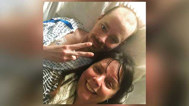 In this Feb. 26, 2019, selfie provided by Bridgette Hoskie, her brother Jay Barrett and herself pose for the photo inside an ICU at Yale New Haven Hospital in New Haven, Conn. Barrett, a terminally ill Connecticut man who's a big supporter of President Donald Trump, is getting a bucket list wish fulfilled, with help from his Democratic sister.
