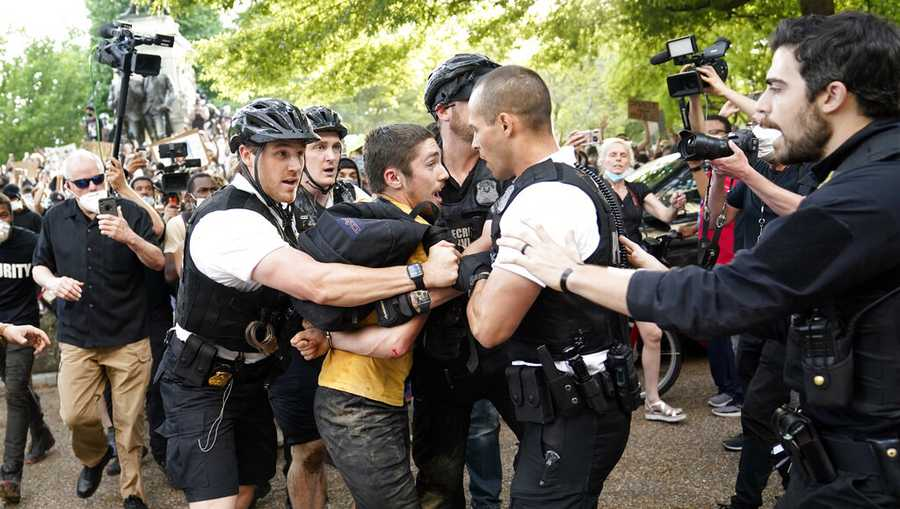 Uniformed U.S. Secret Service police detain a protester in Lafayette Park across from the White House as demonstrators protest the death of George Floyd, a black man who died in police custody in Minneapolis, Friday, May 29, 2020, in Washington.