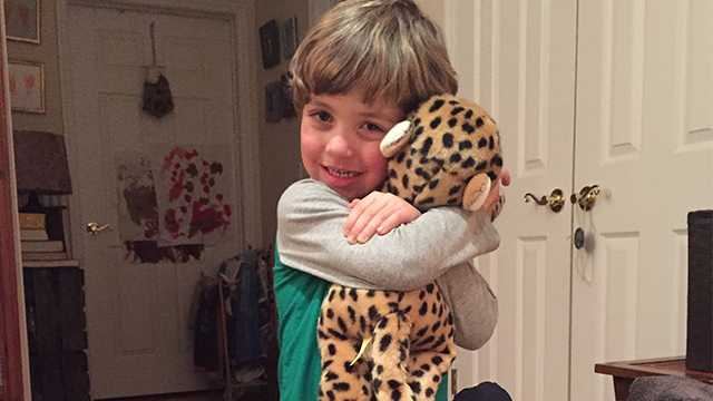 Will Ketcher hugs a stuffed animal that he received from Rhode Island State Police.