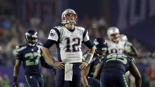 New England Patriots quarterback Tom Brady (12) reacts after throwing an interception during the second half of NFL Super Bowl XLIX football game against the Seattle Seahawks Sunday, Feb. 1, 2015, in Glendale, Ariz.