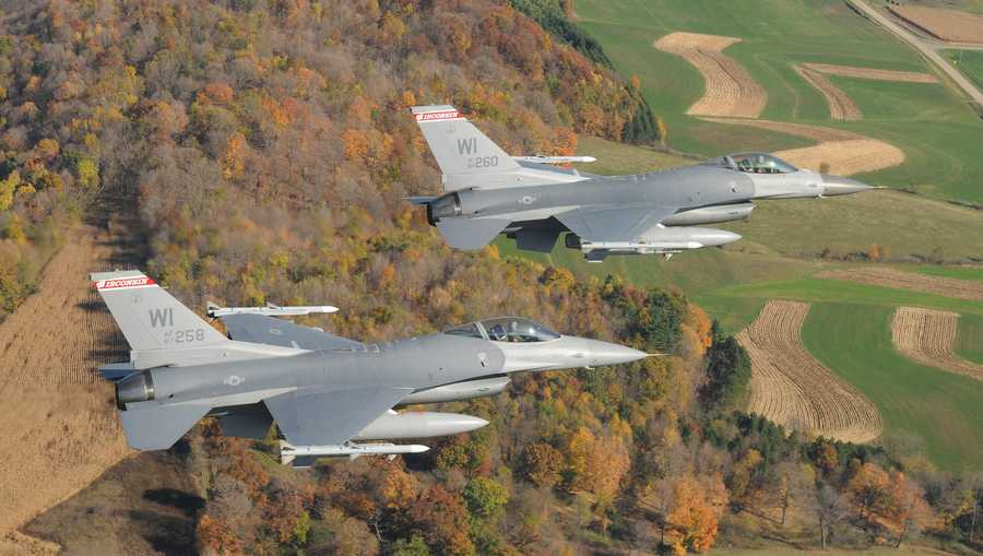 a photo shows two f 16 fighter jets from the 115th fighter wing in madison