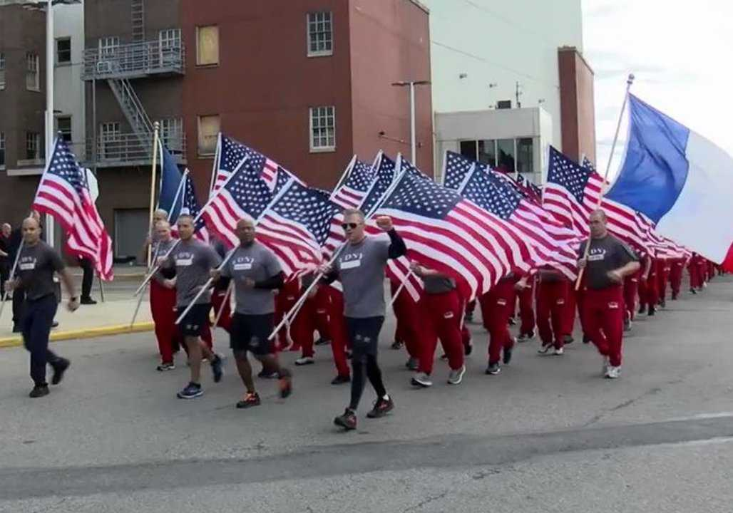New York firefighters run with French flags in tribute to Notre Dame crews thumbnail